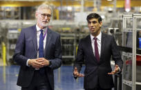 Britain's Chancellor of the Exchequer Rishi Sunak talks with the CEO of Worcester Bosch, Carl Arntzen, left, during a visit to Worcester Bosch factory to promote the initiative, Plan for Jobs, in Worcester, England, Thursday July 9, 2020. (Phil Noble/Pool via AP)