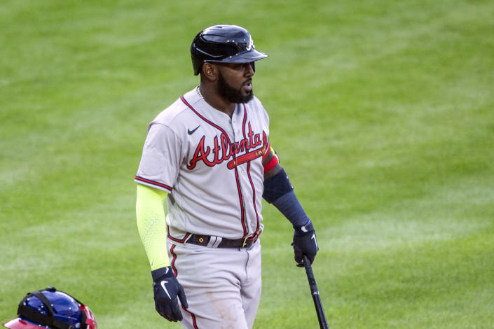 Atlanta Braves' Marcell Ozuna (20) stands with his bat during the seventh inning of a baseball game against the Philadelphia Phillies, Saturday, April 3, 2021, in Philadelphia. The All-Star Game patch that appeared on the right sleeve of the Braves' jerseys during opening day was sewn over Saturday against Philadelphia at Citizens Bank Park. (AP Photo/Laurence Kesterson)