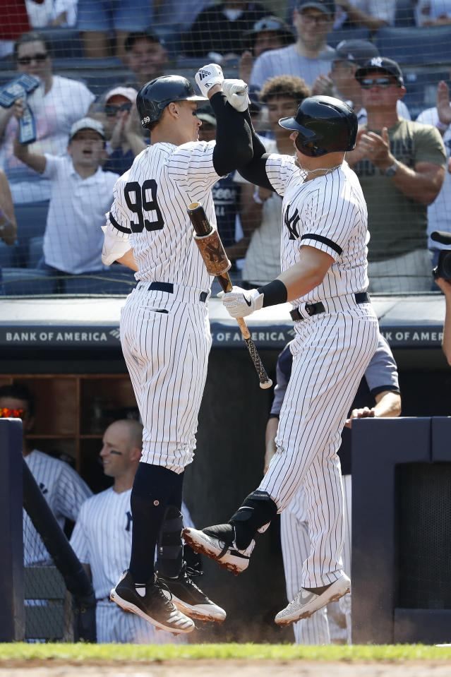 New York Yankees' Aaron Judge, left, celebrates with Luke Voit after hitting a home run against the Toronto Blue Jays during the first inning of a baseball game, Sunday, Sept. 22, 2019, in New York. (AP Photo/Michael Owens)