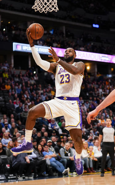 Los Angeles Lakers forward LeBron James goes up for a shot against the Denver Nuggets during the first quarter an NBA basketball game Tuesday, Dec. 3, 2019, in Denver. (AP Photo/Jack Dempsey)