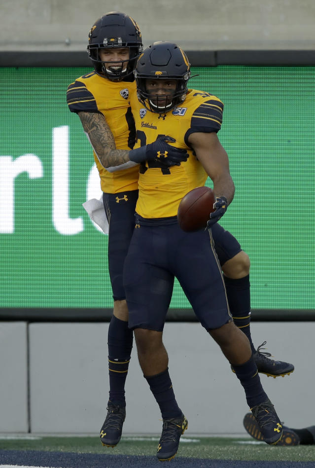 California's Christopher Brown Jr., right, celebrates with Trevon Clark after scoring a touchdown against Washington State in the first half of an NCAA college football game Saturday, Nov. 9, 2019, in Berkeley, Calif. (AP Photo/Ben Margot)