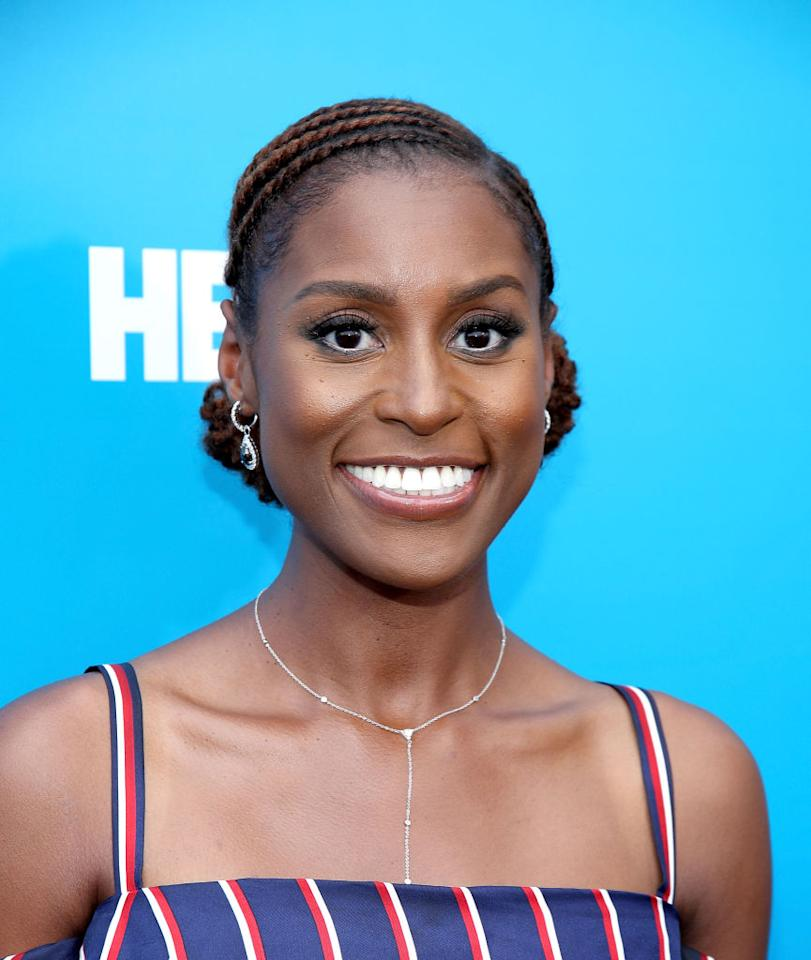 <p><em>Insecure </em>star Issa Rae has been busy promoting (and partying for) the upcoming season of her HBO series. Thanks to hair pro Felicia Leatherwood, the natural hair beauty's mane is always in check, and this twisted and curly chignon 'do is also summer-approved. (Photo: Getty Images) </p>