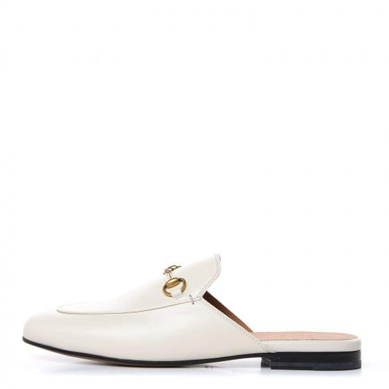 "<p><a href=""https://www.popsugar.com/buy/Gucci-Calfskin-Princetown-Slippers-545495?p_name=Gucci%20Calfskin%20Princetown%20Slippers&retailer=fashionphile.com&pid=545495&price=670&evar1=fab%3Aus&evar9=47168258&evar98=https%3A%2F%2Fwww.popsugar.com%2Ffashion%2Fphoto-gallery%2F47168258%2Fimage%2F47168527%2FGucci-Calfskin-Princetown-Slippers&list1=shopping%2Cvintage%2Cgucci&prop13=mobile&pdata=1"" rel=""nofollow"" data-shoppable-link=""1"" target=""_blank"" class=""ga-track"" data-ga-category=""Related"" data-ga-label=""https://www.fashionphile.com/gucci-calfskin-princetown-womens-slippers-395-mystic-white-469008"" data-ga-action=""In-Line Links"">Gucci Calfskin Princetown Slippers</a> ($670)</p>"