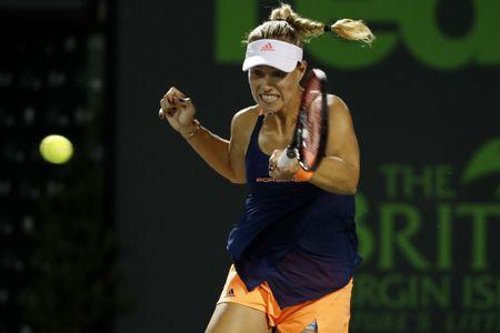 Mar 29, 2017; Miami, FL, USA; Angelique Kerber of Germany hits a forehand against Venus Williams of the United States (not pictured) on day nine of the 2017 Miami Open at Crandon Park Tennis Center. Williams won 7-5, 6-3. Mandatory Credit: Geoff Burke-USA TODAY Sports
