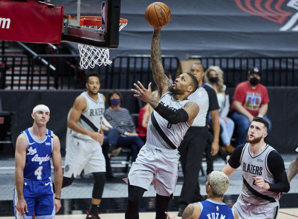 Portland Trail Blazers guard Damian Lillard shoots against the Los Angeles Lakers during the second half of an NBA basketball game in Portland, Ore., Friday, May 7, 2021. (AP Photo/Craig Mitchelldyer)