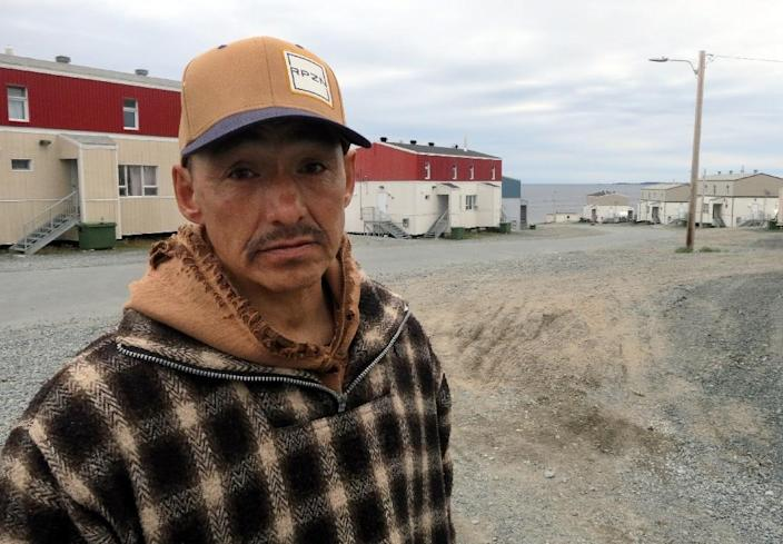 Lucassie Cookie, a local, poses for a photograph in the Inuit village of Umiujaq, in Nunavik territory, Hudson Bay, Quebec (AFP Photo/Catherine Hours)