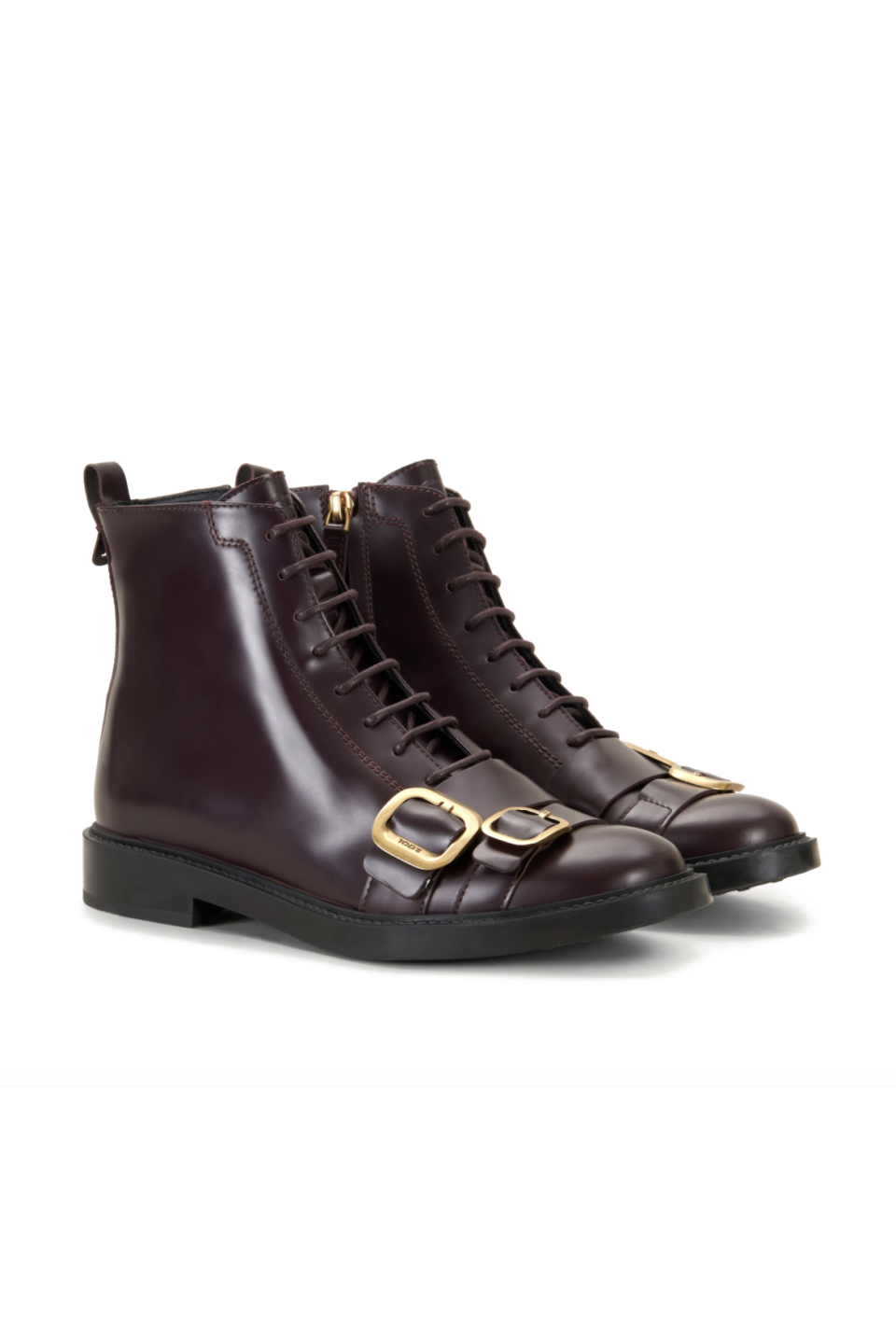 """<p><strong>Tod's</strong></p><p><strong>$895.00</strong></p><p><a href=""""https://go.redirectingat.com?id=74968X1596630&url=https%3A%2F%2Fwww.tods.com%2Fus-en%2FAnkle-Boots-in-Leather%2Fp%2FXXW59C0DL90OG9R817&sref=https%3A%2F%2Fwww.marieclaire.com%2Ffashion%2Fg33469548%2Fbest-ankle-boots-for-women%2F"""" rel=""""nofollow noopener"""" target=""""_blank"""" data-ylk=""""slk:SHOP IT"""" class=""""link rapid-noclick-resp"""">SHOP IT</a></p><p>For a rich color on your ankle boots, slip your foot into this burgundy option. It has an air of elegance thanks to the smooth leather finish and two polished buckle straps. <br></p>"""
