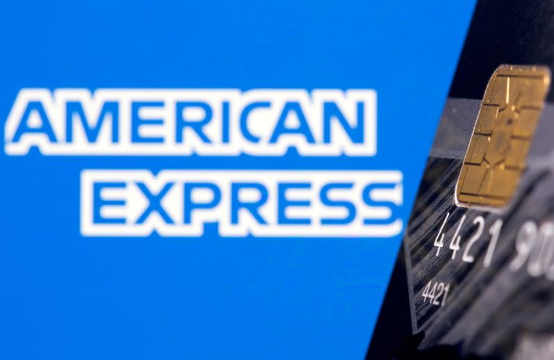 FILE PHOTO: Credit card is seen in front of displayed American Express logo in this illustration