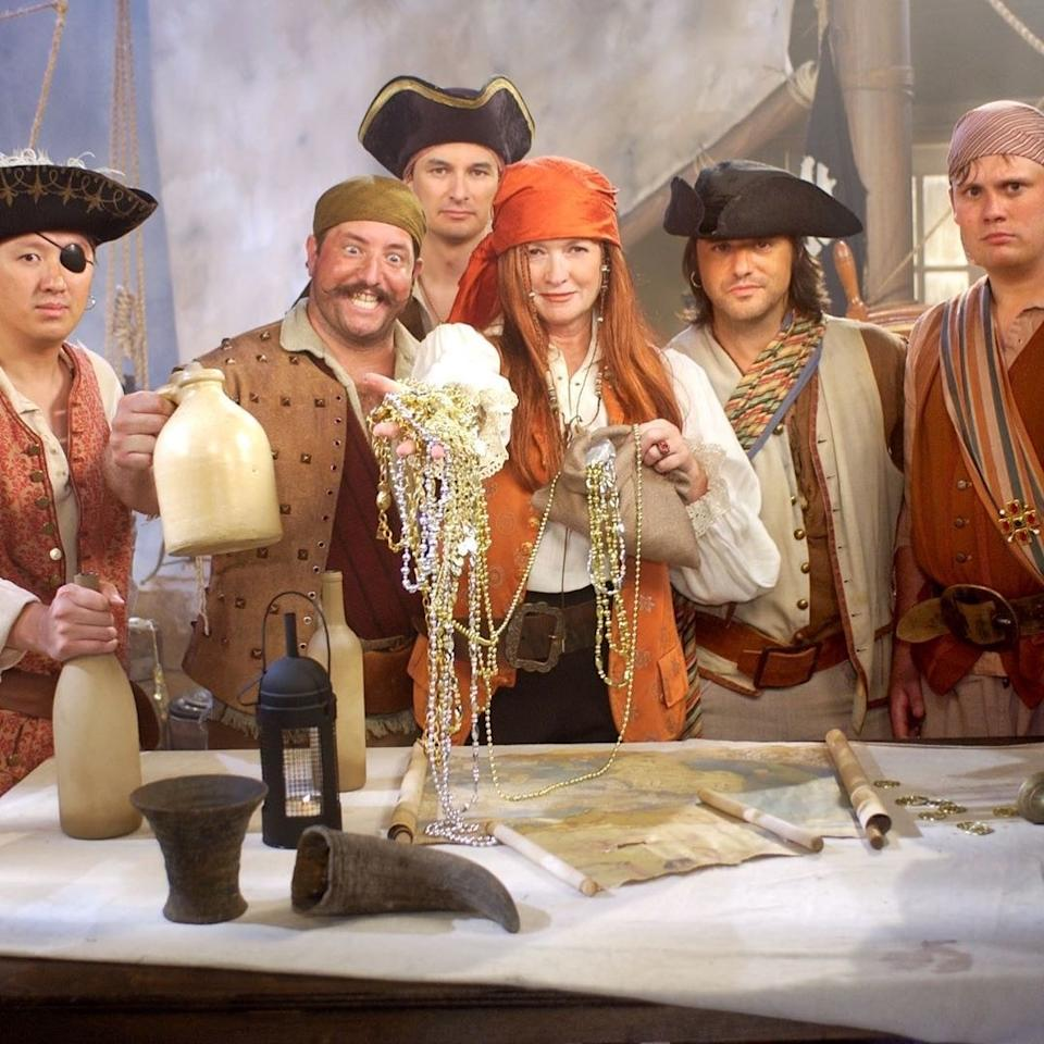 "Martha Stewart dressed as ""Red Pirate Martha,"" along with her ""crew,"" on the Halloween episode of <em>Martha Stewart Living</em>, October 2019."