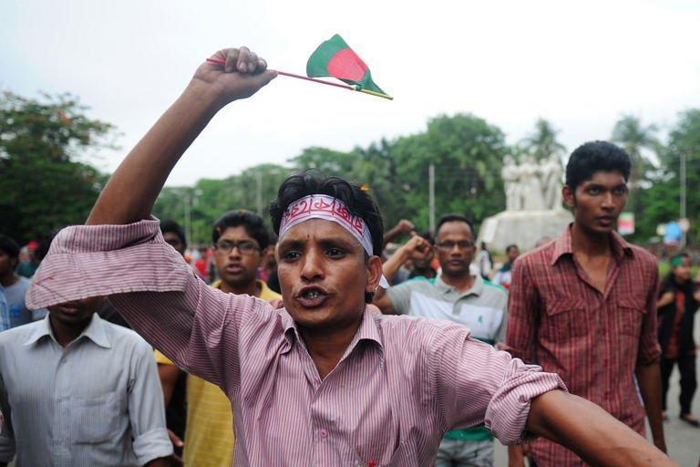 Bangladeshi social activists celebrate after hearing the International Crimes Tribunal's guilty verdict on Mohammad Kamaruzzaman during a rally in Dhaka, on May 9, 2013. A Bangladeshi court has sentenced a top Islamist to death for masterminding the slaughter of at least 120 farmers in one of the bloodiest single episodes of the 1971 independence war