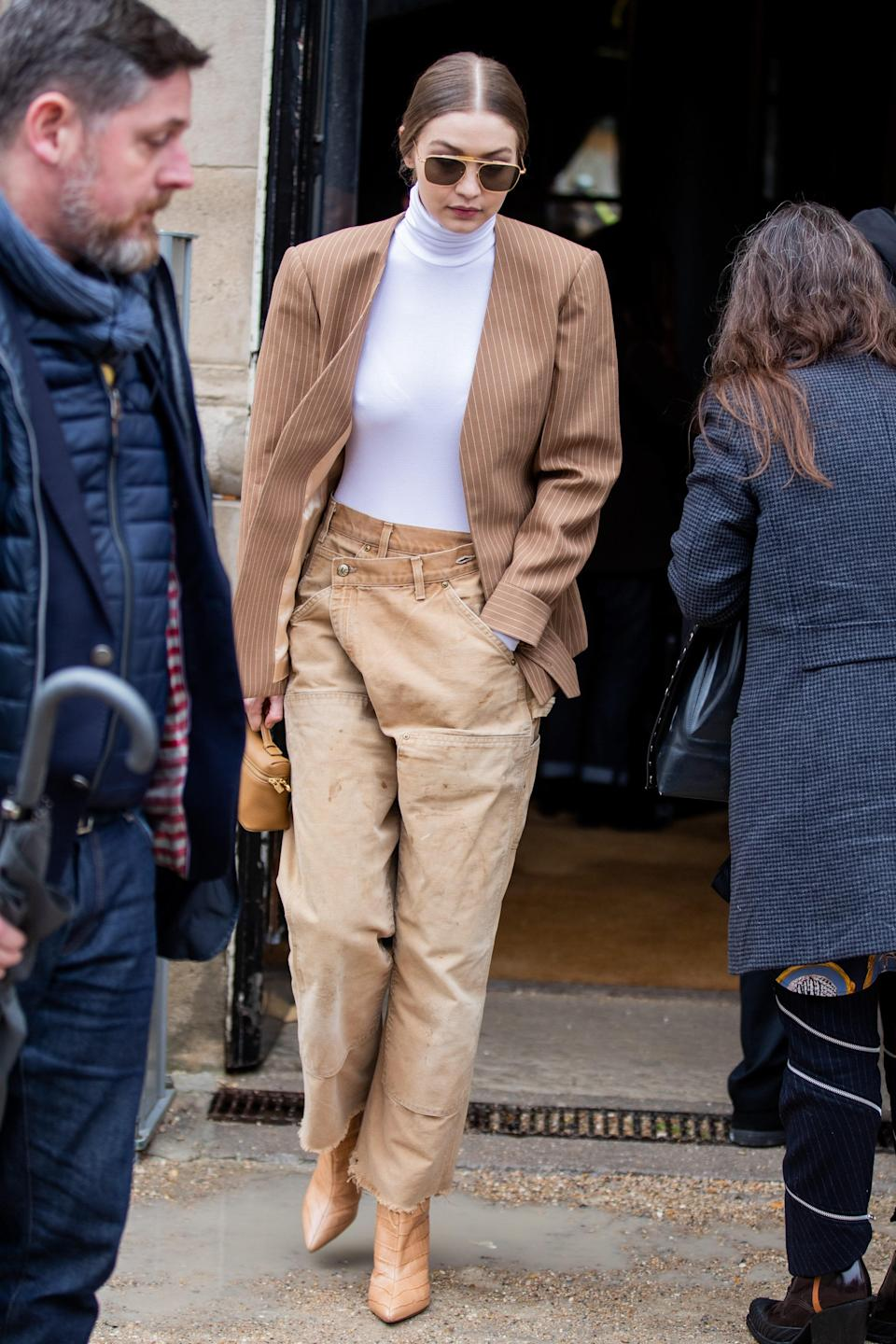 And sticking to one color (or, quasi) means playing with silhouettes. Gigi paired this camel blazer with an asymmetric pair of pants to attend the Chloè show in Paris.