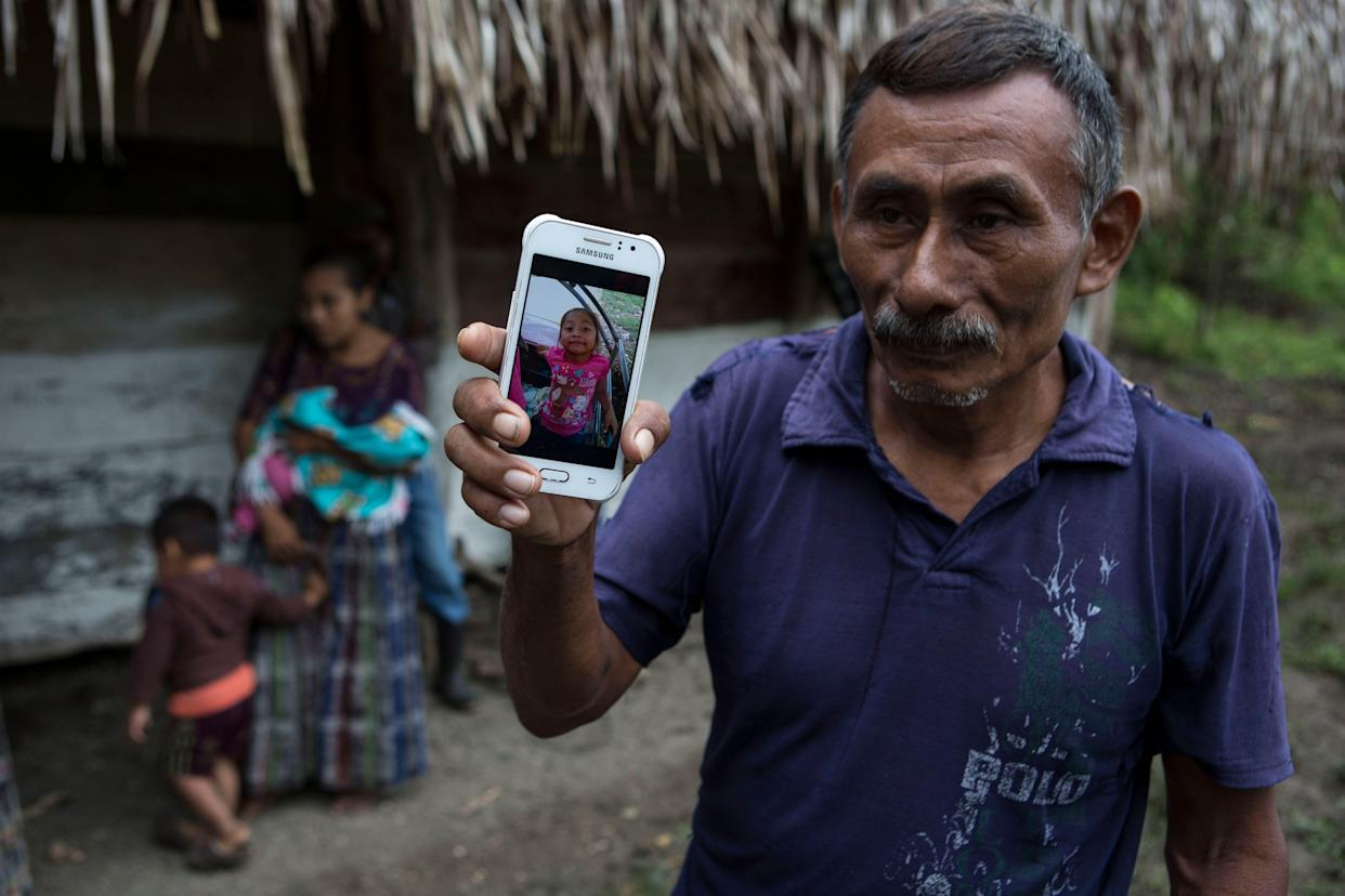 Domingo Caal Chub, 61, displays a smartphone photo of his granddaughter, Jakelin Amei Rosmery Caal Maquin, a 7-year-old girl who died in a Texas hospital two days after being taken into custody by Border Patrol agents. (Photo: Oliver de Ros/AP)