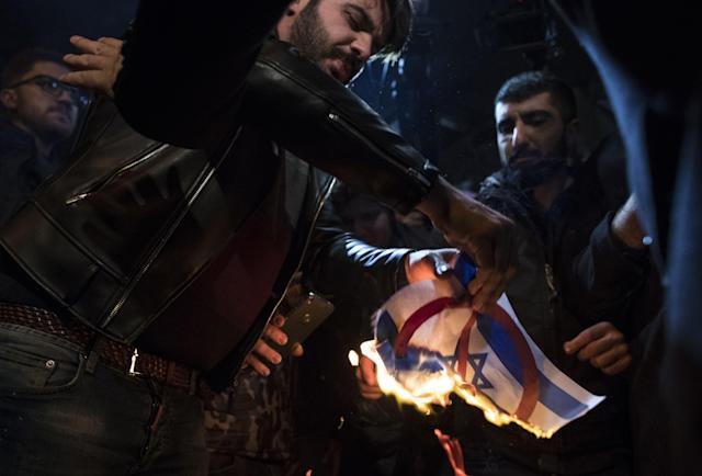 <p>Protestors burn Israeli flag and shout slogans against President Donald Trump during a protest against the Israel in front of U.S. Consulate in Istanbul, Turkey, Dec. 6, 2017. (Photo:Tolga Bozoglu/EPA-EFE/REX/Shutterstock) </p>
