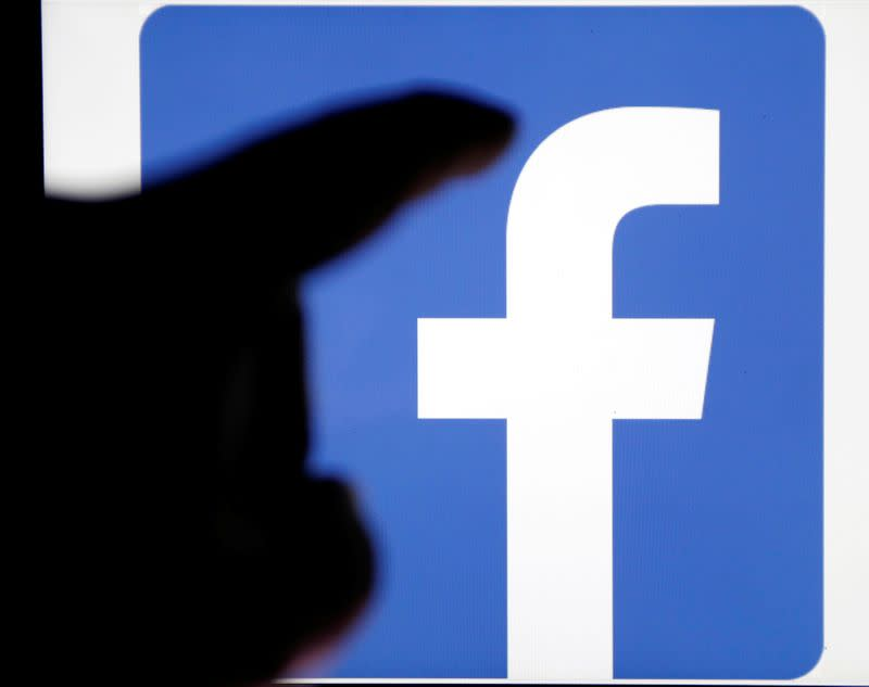 FILE PHOTO: A Facebook logo is pictured on an Apple's Ipad in Bordeaux, southwestern France