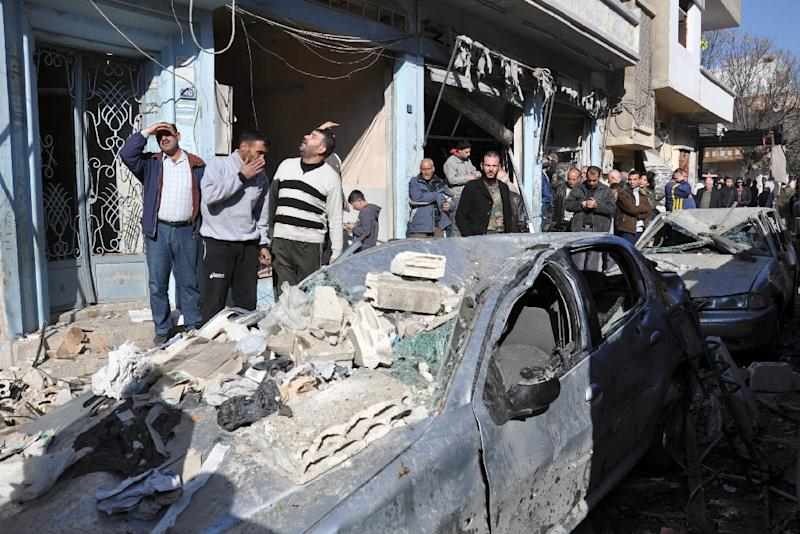 Syrians gather at the site of a car bomb explosion in al-Zahra neighborhood in Homs on December 12, 2015 (AFP Photo/)