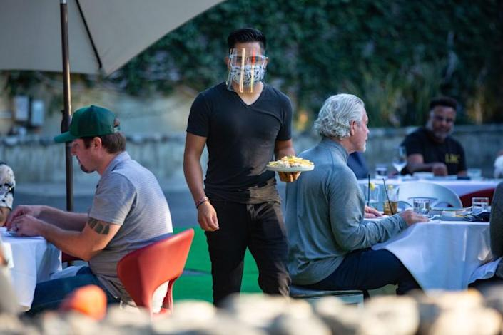 "Customers dine on the patio at La Boheme in West Hollywood. Restaurants in Los Angeles County are allowed to serve customers only outdoors. <span class=""copyright"">(Jason Armond / Los Angeles Times)</span>"