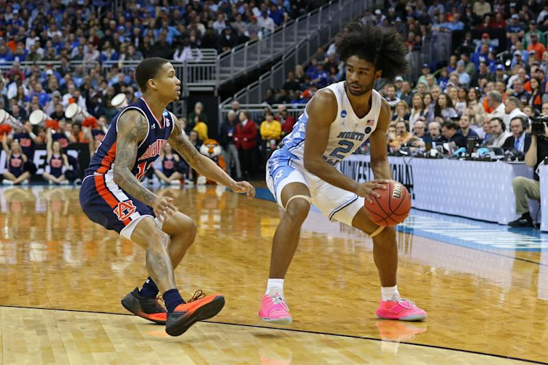KANSAS CITY, MO - MARCH 29: North Carolina Tar Heels guard Coby White (2) keeps the ball away from Auburn Tigers guard J'Von McCormick (12) in the second half of an NCAA Midwest Regional Sweet Sixteen game between the Auburn Tigers and North Carolina Tar Heels on March 29, 2019 at Sprint Center in Kansas City, MO. (Photo by Scott Winters/Icon Sportswire via Getty Images)