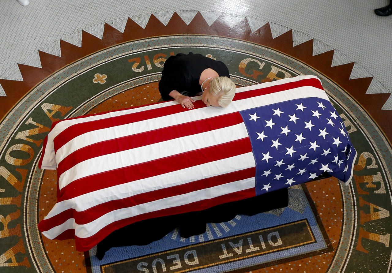 <p>Cindy McCain, wife of, Sen. John McCain, R-Ariz. lays her head on casket during a memorial service at the Arizona Capitol on Wednesday, Aug. 29, 2018, in Phoenix. (Photo: Ross D. Franklin, Pool/AP) </p>