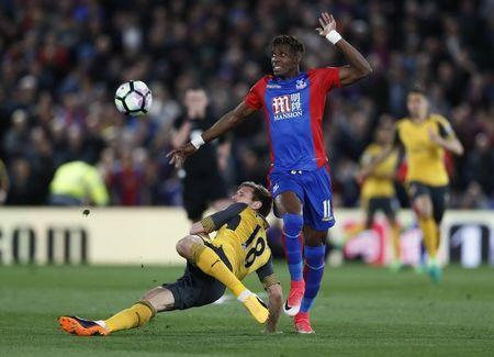 Britain Football Soccer - Crystal Palace v Arsenal - Premier League - Selhurst Park - 10/4/17 Arsenal's Nacho Monreal in action with Crystal Palace's Wilfried Zaha Reuters / Stefan Wermuth Livepic .