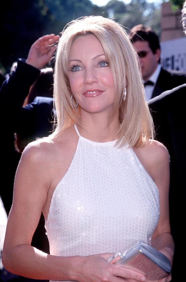 <p>Locklear's sleek, layered lob and fresh face of makeup made her glow at the Emmys in 1999. </p>