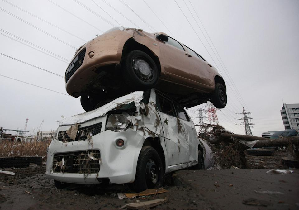 <p>FILE PHOTO: Vehicles damaged during the tsunami are seen in Sendai City after an 9.0 magnitude strong earthquake struck on March 11, off the coast of north-eastern Japan, on March 15, 2011 in Miyagi Prefecture, Japan. (Photo: XINHUA/Gamma-Rapho via Getty Images)</p>