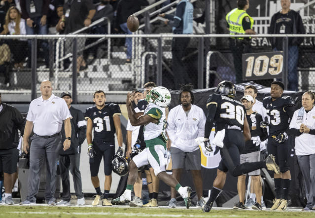 South Florida wide receiver Kelley Joiner Jr. (10) catches a long pass in front of Central Florida defensive lineman Tre'Mon Morris-Brash (30) during the first half of an NCAA college football game Friday, Nov. 29, 2019, in Orlando, Fla. (AP Photo/Willie J. Allen Jr.)