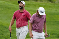 Jon Rahm, of Spain,left and Cameron Smith, of Australia, react on the fifth hole in the final round at The Northern Trust golf tournament at Liberty National Golf Course Monday, Aug. 23, 2021, in Jersey City, N.J. (AP Photo/John Minchillo)