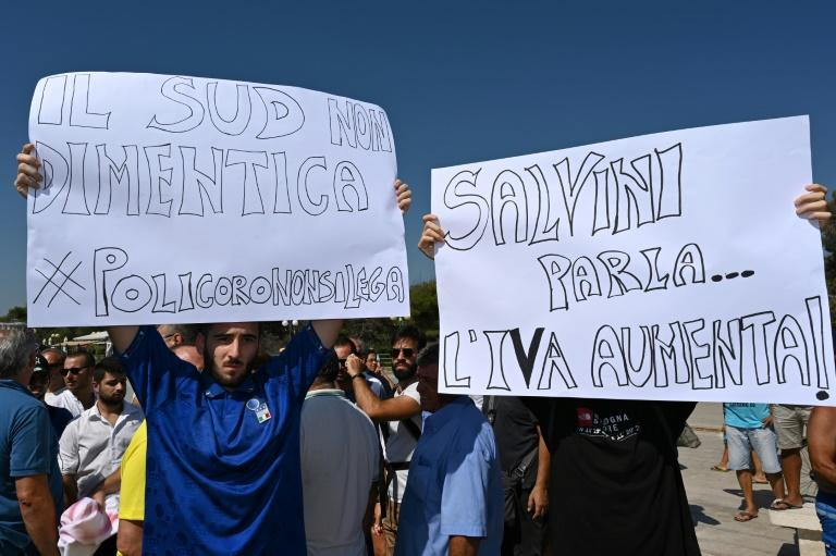 Anti-Salvini signs held up by protesters in Policoro in southern Italy