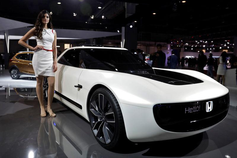 A Model Poses Alongside Honda Sports Ev Concept Car At The India Auto Show 2018 In