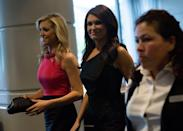 """<p>Guilfoyle, pictured here at the White House Correspondents' Association Dinner in 2014, was <a href=""""https://www.politico.com/story/2016/12/press-secretary-kimberly-guilfoyle-232658"""" rel=""""nofollow noopener"""" target=""""_blank"""" data-ylk=""""slk:spotted meeting with the Trump transition team at Trump Tower in December 2016"""" class=""""link rapid-noclick-resp"""">spotted meeting with the Trump transition team at Trump Tower in December 2016</a>.</p>"""