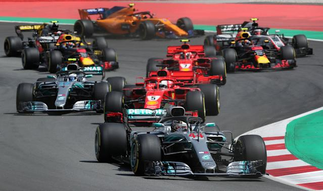 Formula One F1 - Spanish Grand Prix - Circuit de Barcelona-Catalunya, Barcelona, Spain - May 13, 2018 Mercedes' Lewis Hamilton leads Ferrari's Sebastian Vettel at the first corner during the race REUTERS/Albert Gea