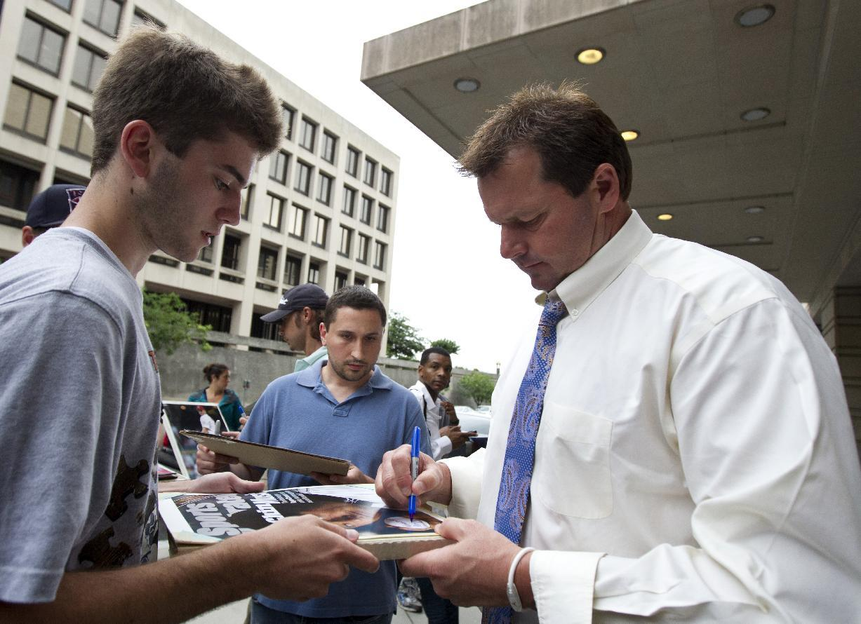 Former Major League Baseball pitcher Roger Clemens signs autographs as he leaves the Federal Court in Washington Tuesday, June 12, 2012. Clemens' fate is in the hands of a jury that will decide if the former pitcher lied about performance-enhancing substances. The panel of eight women and four men began deliberations after a day of closing arguments in the ninth week of the trial. (AP Photo/Manuel Balce Ceneta)