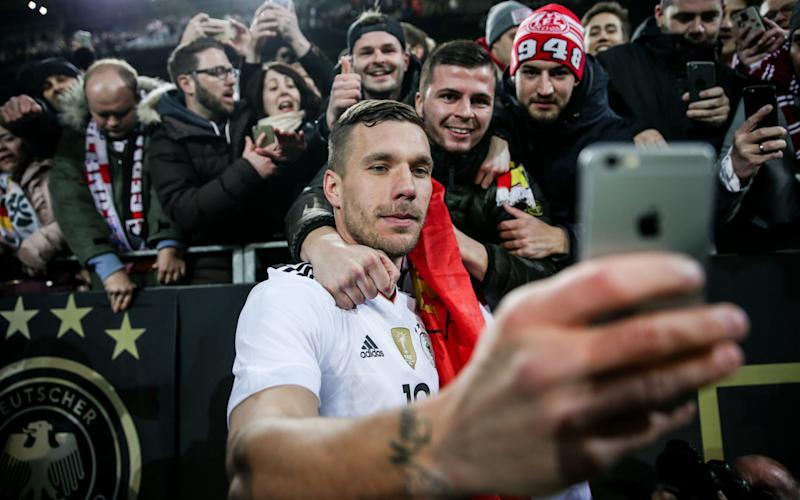Podolski takes a selfie as a memento of his night