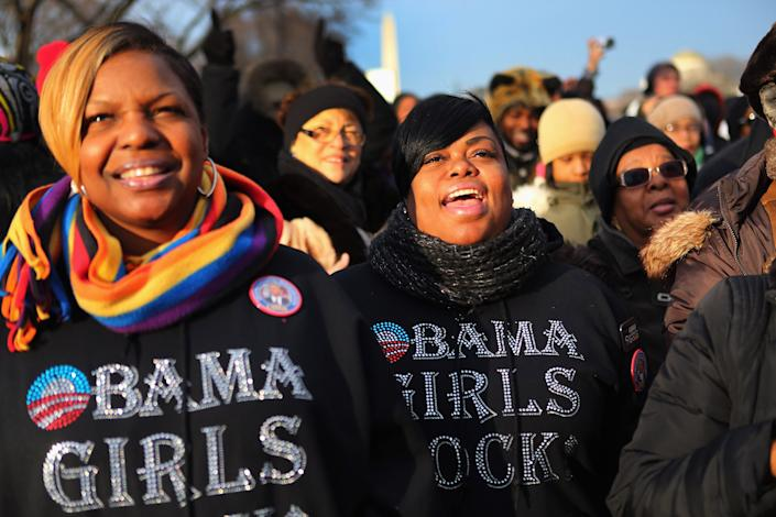 Rickita Glass (L) and Kelly Grimes and others gather near the U.S. Capitol building on the National Mall for the Inauguration ceremony on January 21, 2013 in Washington, DC. U.S. President Barack Obama will be ceremonially sworn in for his second term today. (Photo by Joe Raedle/Getty Images)