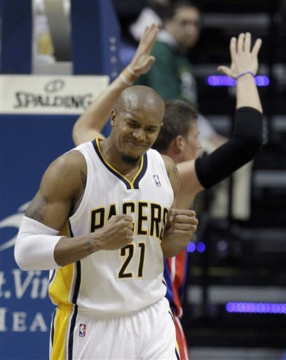Indiana Pacers' David West reacts after getting fouled on a play by Detroit Pistons' Jonas Jerebko, right, during the first half of an NBA basketball game Monday, Dec. 26, 2011, in Indianapolis. (AP Photo/Darron Cummings)