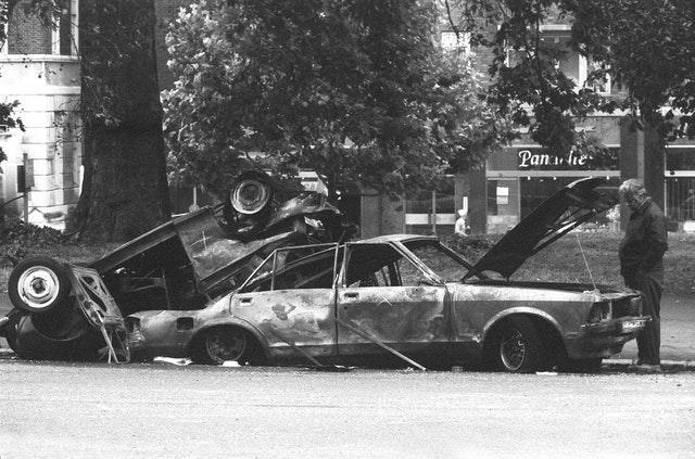 Police forensic officers working on the remains of the car which housed the Hyde Park car bomb in 1982