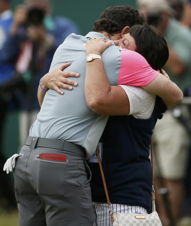 Rory McIlroy of Northern Ireland celebrates with his mother Rosie on the 18th green after winning the British Open Championship at the Royal Liverpool Golf Club in Hoylake, northern England July 20, 2014. REUTERS/Stefan Wermuth (BRITAIN - Tags: SPORT GOLF)