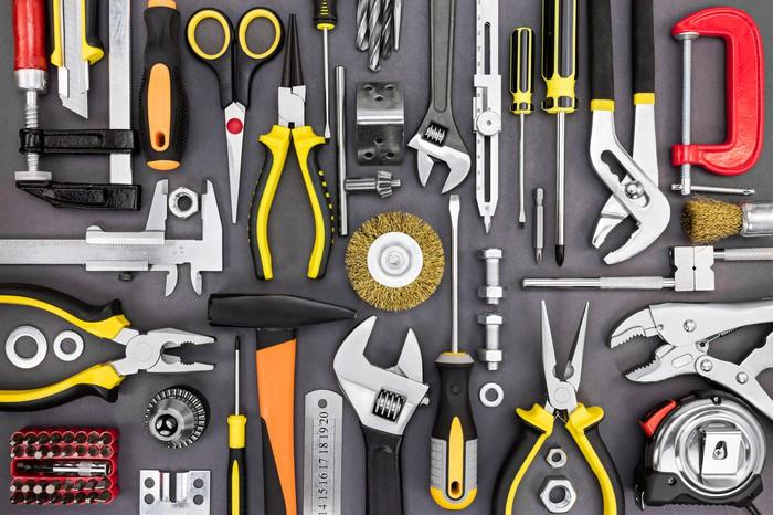 A collection of wrenches, pliers, screwdrivers, and other hand tools