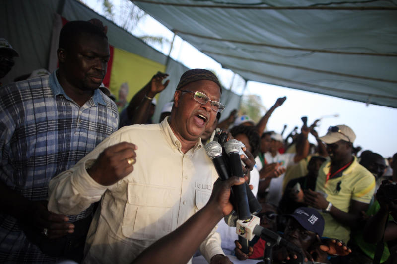 FILE - In this March 16, 2012 file photo, presidential candidate and Prime Minister Carlos Gomes Junior speaks at a rally on the final day of electoral campaigning ahead of the first round of presidential voting, in Bissau, Guinea-Bissau. Explosions blasted through the capital of the small, coup-prone nation of Guinea-Bissau on Thursday as the military sealed off the city's downtown area and lobbed grenades at the prime minister's home, according to a diplomat and witnesses. (AP Photo/Gabriela Barnuevo, File)