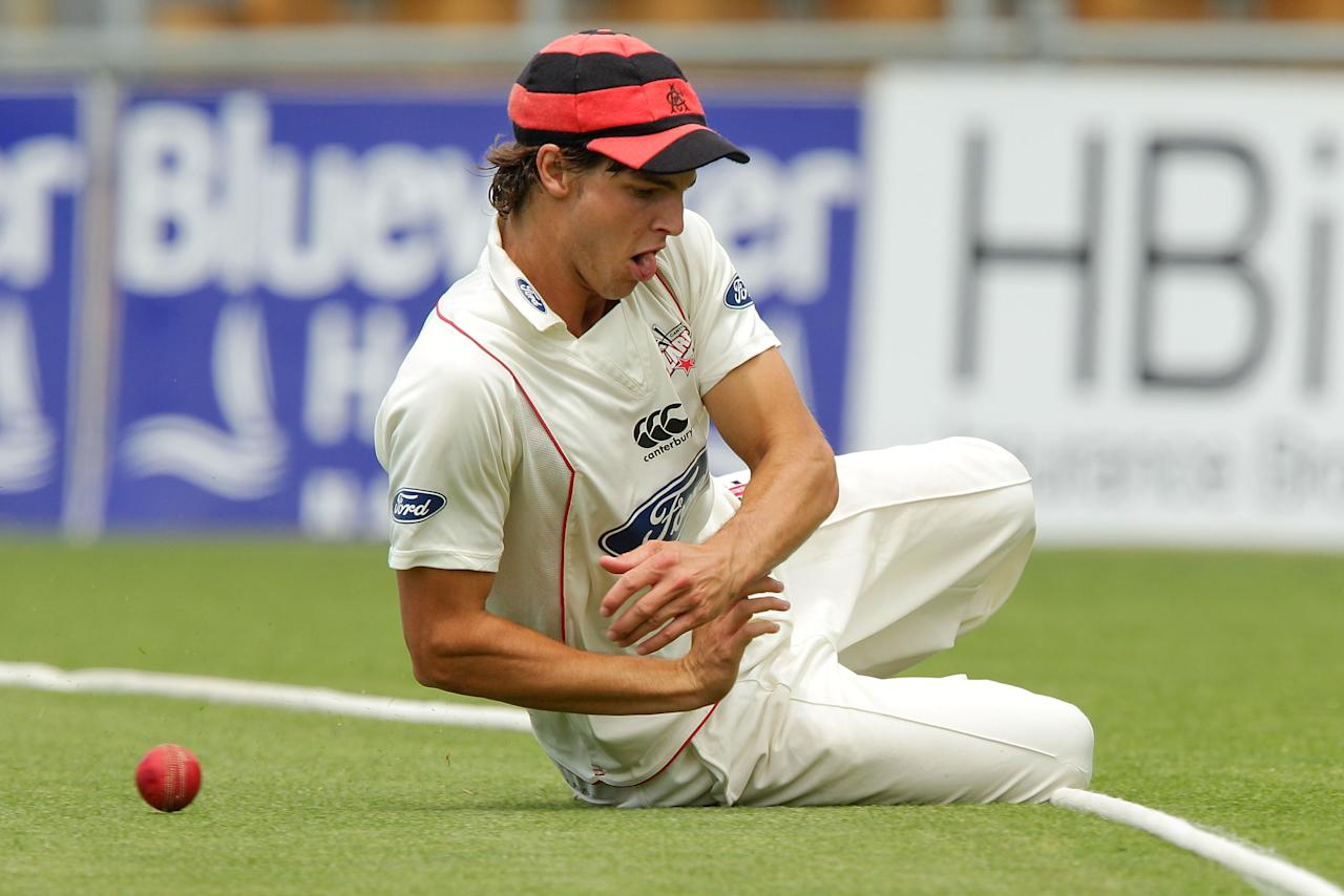 NAPIER, NEW ZEALAND - JANUARY 24:  Ryan McCone of the Wizards fields the ball before the boundary during the Plunket Shield match between the Central Stags and the Cantebury Wizards at McLean Park on January 24, 2013 in Napier, New Zealand.  (Photo by Hagen Hopkins/Getty Images)