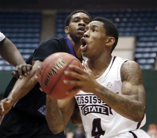 Mississippi State guard Trivante Bloodman (4) looks up as he drives towards the basket past Central Arkansas guard Ryan Williams (5) in the first half of an NCAA college basketball game against in Jackson, Miss., Saturday, Dec. 22, 2012. (AP Photo/Rogelio V. Solis)