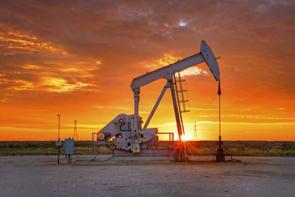 Oil pump during a beautiful golden sunrise.