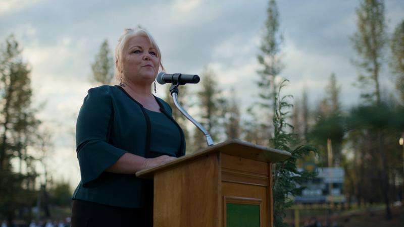 """Michelle John addresses Paradise High School graduates in a scene from the documentary """"Rebuilding Paradise."""" <span class=""""copyright"""">(National Geographic)</span>"""