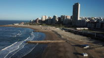 The beach is empty during the COVID-19 pandemic in Mar del Plata, Argentina, late morning on Saturday, Oct. 10, 2020. The beach resort has 26% unemployment, twice the national rate, partly as a result of seven months of lockdown measures. (AP Photo/Natacha Pisarenko)