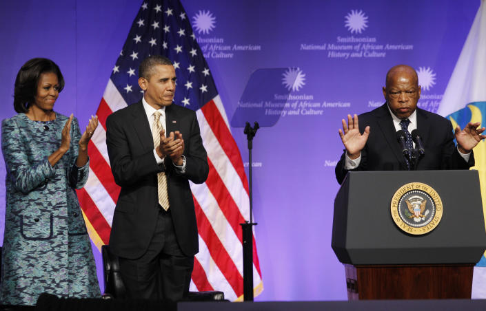 President Barack Obama and first lady Michelle Obama applaud as Rep. John Lewis, D-Ga., speaks at the groundbreaking for the Smithsonian National Museum of African American History and Culture in Washington on Feb. 22, 2012. (Photo: Charles Dharapak/AP)