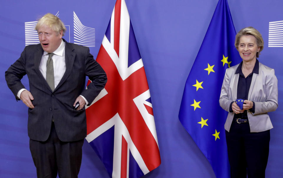 FILE - In this Wednesday, Dec. 9, 2020 file photo European Commission President Ursula von der Leyen, right, welcomes British Prime Minister Boris Johnson prior to a meeting at EU headquarters in Brussels. Britain and the European Union have struck a provisional free-trade agreement that should avert New Year's chaos for cross-border commerce and bring a measure of certainty to businesses after years of Brexit turmoil. The breakthrough on Thursday, Dec. 24, 2020 came after months of tense and often testy negotiations that whittled differences down to three key issues: fair-competition rules, mechanisms for resolving future disputes and fishing rights. (Olivier Hoslet, Pool via AP, File)