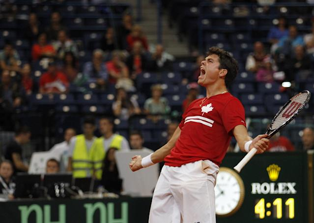 Milos Raonic of Canada celebrates after their Davis Cup semifinal tennis match against Janko Tipsarevic of Serbia, in Belgrade, Serbia, Friday, Sept. 13, 2013. (AP Photo/Darko Vojinovic)