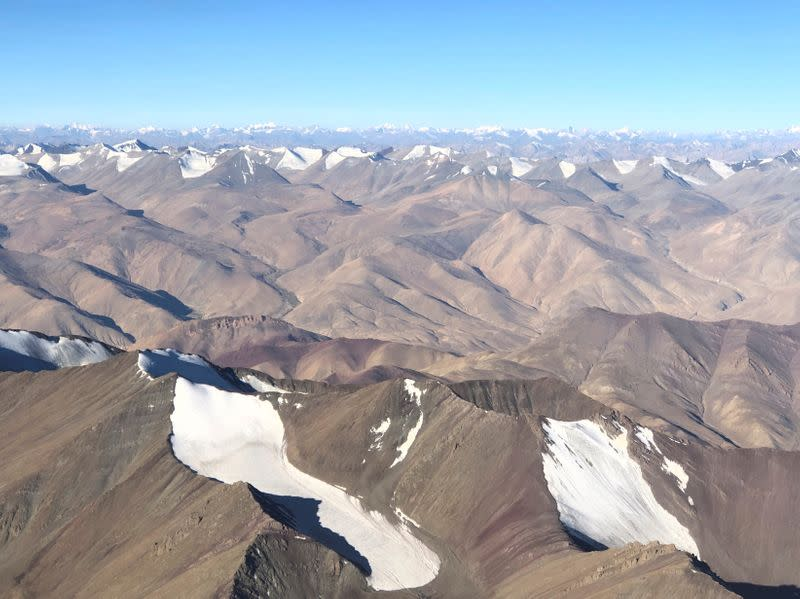 FILE PHOTO: Snow-covered mountain range is seen from a passenger airplane in Ladakh region