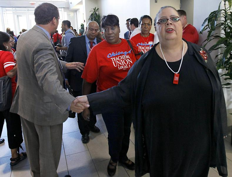 "Karen Lewis, president of the Chicago teachers union, departs a news conference after her meeting with the union's House of Delegates Friday, Sept. 14, 2012, in Chicago. Lewis told the delegates that a ""framework"" was in place to end the teachers strike. (AP Photo/Charles Rex Arbogast)"