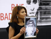 FILE - In this Dec, 16, 2015 file photo, Ensaf Haidar, wife of the jailed Saudi Arabian blogger Raif Badawi, shows a portrait of her husband as he is awarded the Sakharov Prize, in Strasbourg, France. Saudi Arabia has given Canada's ambassador 24 hours to leave the kingdom after Canada criticized the recent arrest of women's rights activists. Among the arrested activists is Samar Badawi, whose writer brother Raif Badawi was arrested in Saudi Arabia in 2012 and later sentenced to 1,000 lashes and 10 years in prison for insulting Islam while blogging. (AP Photo/Christian Lutz, File)
